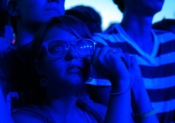 Paiden Carver, 17, of Beals Island watches OK Go perform at KahBang on the Bangor Waterfront on Saturday, Aug. 14, 2010.