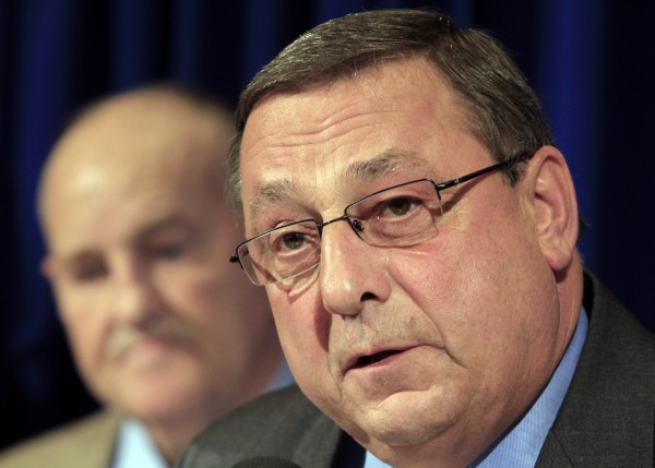 Gov.-elect Paul LePage is seen in November announcing Sawin Millett as one of cabinet selections.  Officials with the LePage transition team say they are having trouble filling Cabinet posts because of relatively low pay and competition from other states. (AP Photo)
