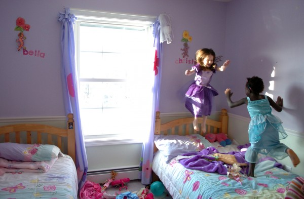 Sisters Bella, 4, (left) and Christella, 5, Logiodice play in their room Friday, Jan. 29, 2010 at their Pittsfield home. Their parents, Amanda and Jediah Logiodice, were united with their two adopted children from Haiti including Christella on Wednesday. Their mother recounted how after tucking the two girls into bed their first night,  she discovered in the morning that Bella had crawled into bed with her new sister.