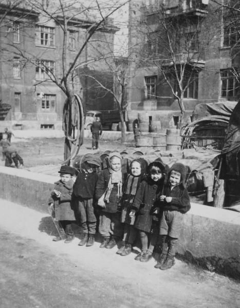 Children playing in the courtyard of the Deutsche Haus (German House) in Odessa, c 1942-43?