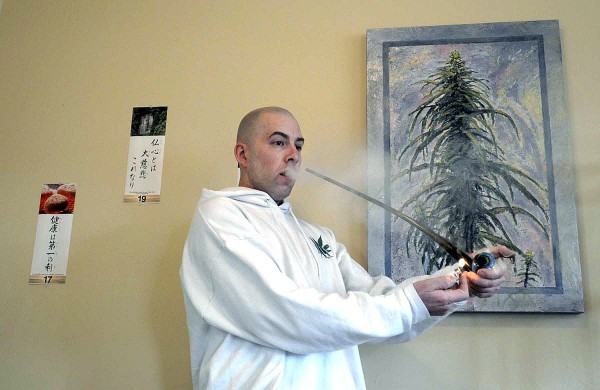 Jason Christ with Montana Caregivers Network lights up a bowl of marijuana at his Missoula, Montana business in this April 2010 file photo.