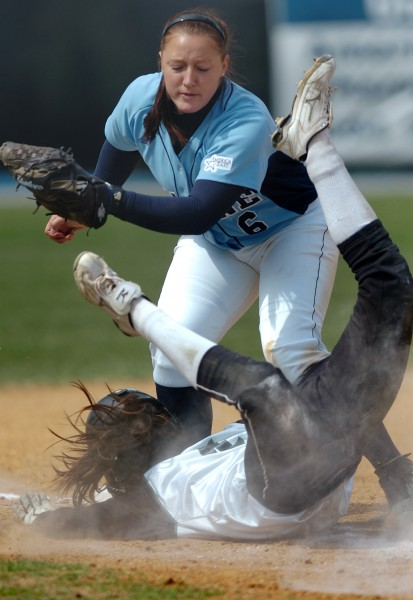 Maine junior Tarren Hall (top) tags out Binghamton freshman Shannon Kane at third base in the sixth inning of Sunday's game, April 11, 2010 at Mike Kessock Field in Orono. Maine won 3-2.