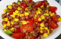 Black beans with corn and tomatoes is a tasty, meat-free dish.