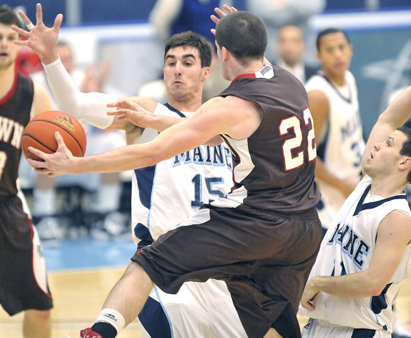 Maine's Troy Barnies (15) and Andrew Rodgers (11) try to block Brown's Sean McGonagill (22) in the paint during the first half of their game in Orono, Saturday, Dec. 4, 2010. Brown defeated Maine 62-54. BangorDailyNews/Michael C. York