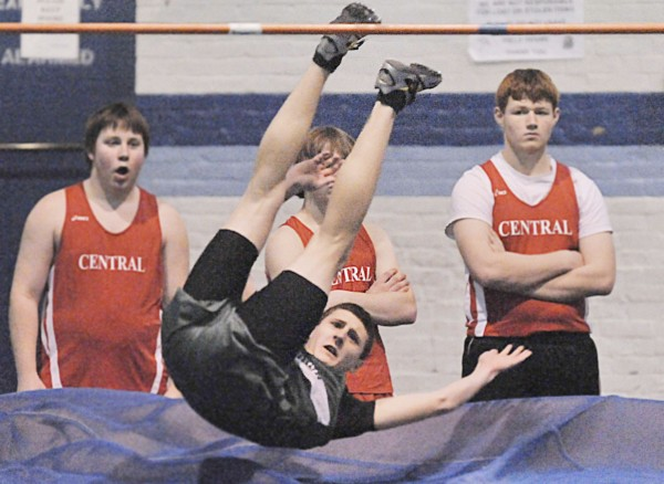 Old Town's Jake Leithiser looks up as he clears 6 feet, 3 inches in the high jump during a multi-team EMITL meet Saturday in Orono. Leithiser won the event. Bangor Daily News/Michael C. York