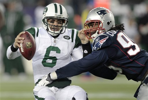 New England Patriots linebacker Jermaine Cunningham, right, almost sacks New York Jets quarterback Mark Sanchez (6), who is forced to throw and incomplete pass, during the fourth quarter of an NFL football game, Monday, Dec. 6, 2010, in Foxborough, Mass. (AP Photo/Charles Krupa)