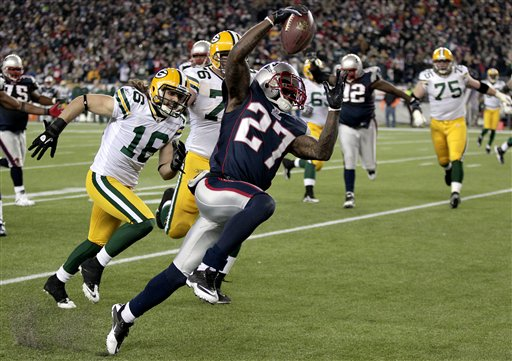 New England Patriots cornerback Kyle Arrington (27) takes a pick-six into the end zone as Green Bay Packers wide receiver Brett Swain (16) and offensive tackle Chad Clifton (76) chase during the third quarter of their NFL football game in Foxborough, Mass., Sunday night, Dec. 19, 2010. (AP Photo/Charles Krupa)