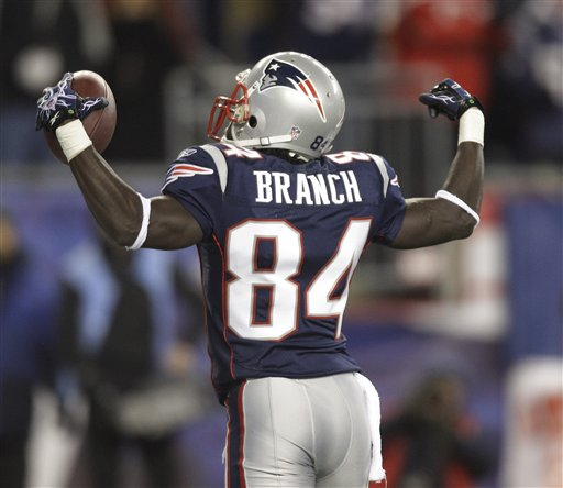 New England Patriots wide receiver Deion Branch (84) celebrates after catching a touchdown pass during the first half of their NFL football game against the New York Jets  Monday night, Dec. 6, 2010, in Foxborough, Mass. (AP Photo/Stephan Savoia)