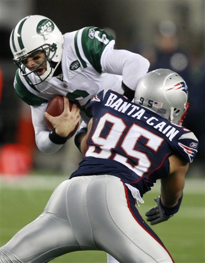 New England Patriots linebacker Tully Banta-Cain (95) hits New York Jets quarterback Mark Sanchez (6) in the second quarter of an NFL football game, Monday, Dec. 6, 2010, in Foxborough, Mass. (AP Photo/Michael Dwyer)