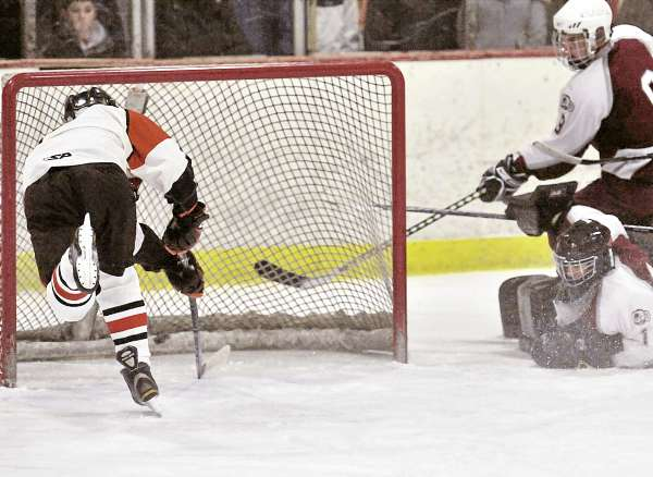 Lamond leads Brewer hockey team by rival Rams
