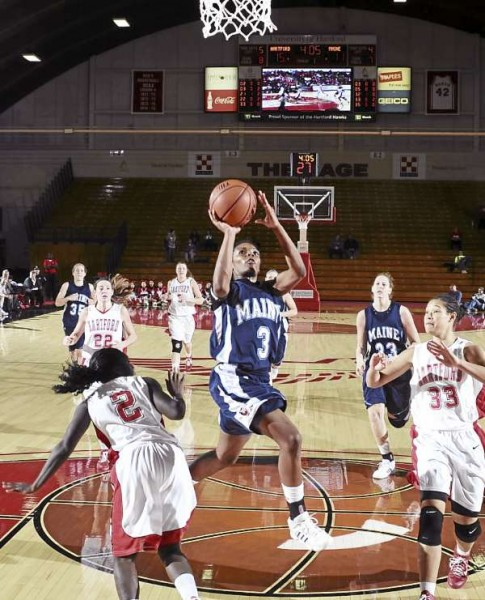 Brittany Williams of the University of Maine (3) slices down the lane against Hartford during Wednesday night's America East game at Chase Family Arena in West Hartford, Conn. The Hawks beat the Black Bears 73-43..