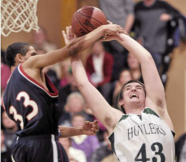 Penquis' Jerel Arefein (33) fouls Penobscot Valley's Joe McCloskey (43) as he takes a shot in the second half of their game in Howland, Thursday, Jan. 6, 2011. (Bangor Daily News/Michael C. York)