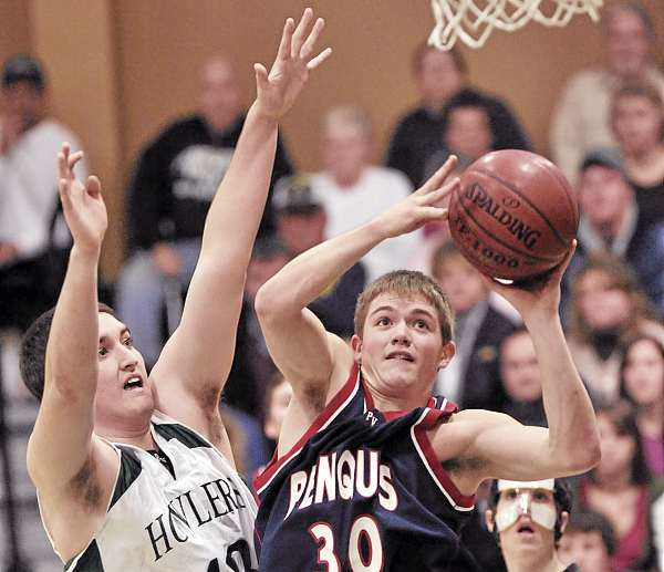 Penquis' Taylor Delano (30) pulls up and shoots a baseline jumper by Penobscot Valley's Joe McCloskey in the first half of their high school basketball game in Howland Thursday, Jan. 6, 2011. (Bangor Daily News/Michael C. York)