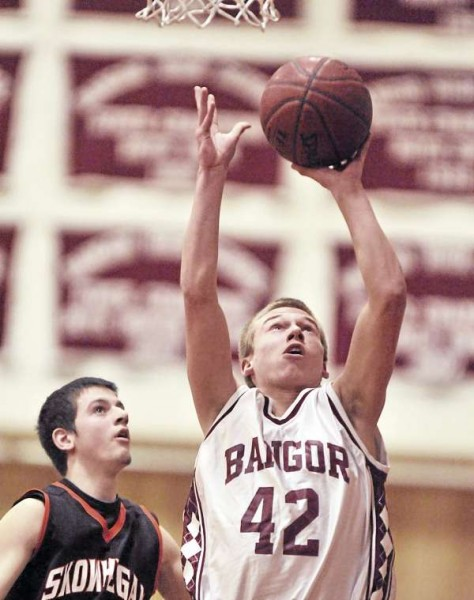 Bangor forward Zach Campbell (42) puts up a shot past Skowhegan defender Levi Barnes in the second half of their game in Bangor Friday.