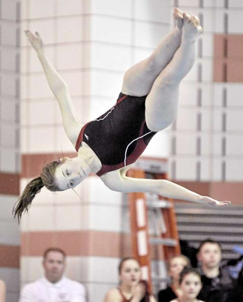 Bangor diver Julie Clifford competes in the 1-meter diving program against Brewer Saturday, Jan. 8, at the YWCA pool in Bangor. Clifford won the event with 185.90 points and Bangor won the meet 145-41.