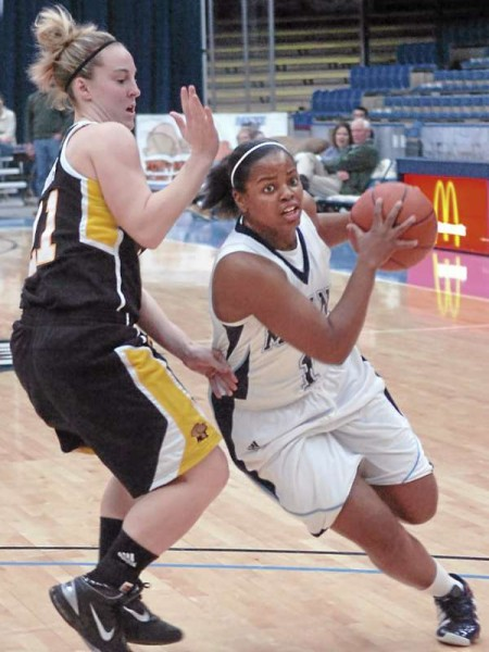 The University of Maine's Ashleigh Roberts gets past The University of Maryland Baltimore County's Michele Brokans during the first half at Alfond Arena in Orono on Sunday, January 9, 2011.