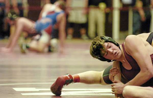 Nokomis' Zack McFarlin holds Foxcroft Academy's Corey Bjornson as the they compete in the 171-pound weight class during Nokomis' wrestling tournament on Saturday, January 8, 2011.