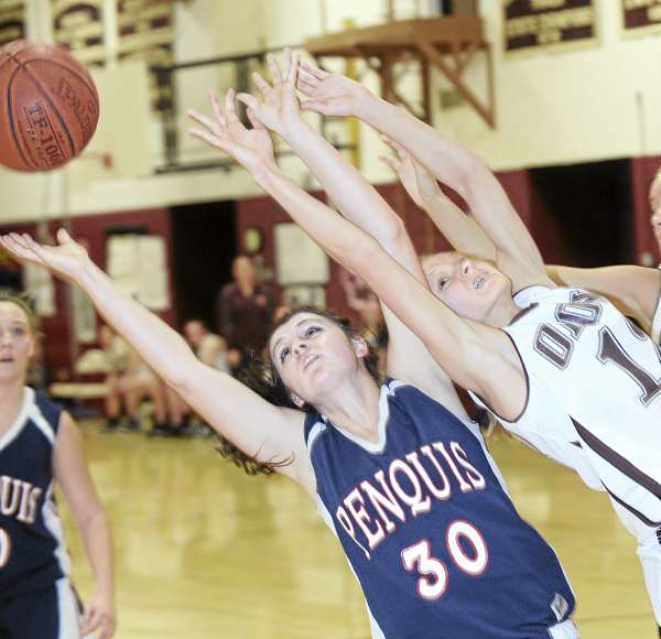 Sadie Zambrano (left) of Penquis Valley High School of Milo and Orono High School's Kate Berry battle for a rebound during the first half of their girls basketball game in Orono Monday night. Orono won 69-51.