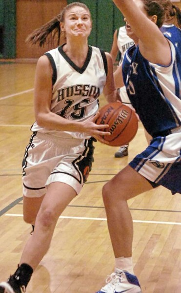 Husson's Brianna Hanscom drives to the basket past Colby's Jules Kowalski during the first-half of action on Tuesday, January 11, 2011, at Husson University in Bangor.