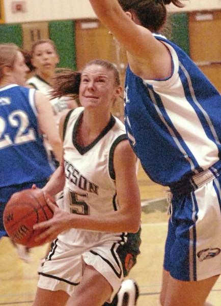 Husson's Brianna Hanscom looks to get past Colby's Jules Kowalski during the first-half of action on Tuesday, January 11, 2011, at Husson University in Bangor.