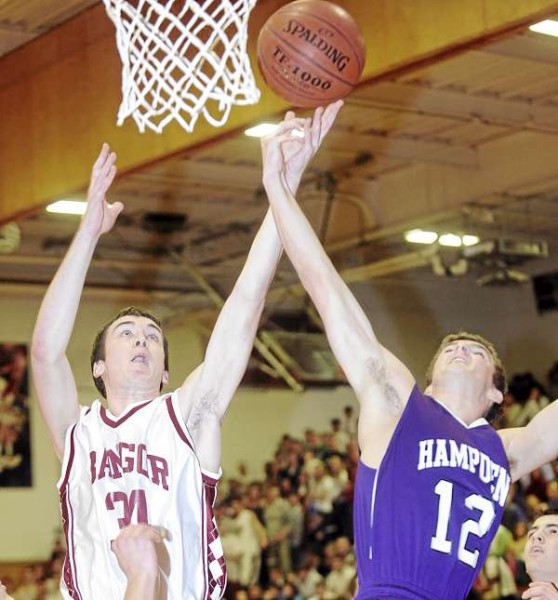 Bangor High School's Sean Mackintosh (left) and  Hampden Academy's Matt Meo go up for a rebound during the first half of the game in Bangor Friday evening.