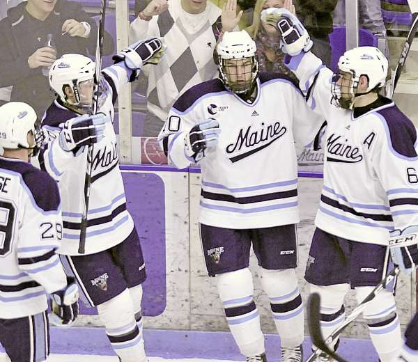 Tanner House (29), Gustav Nyquist (89) and defenseman Jeff Dimmen (6) congratulate Brian Flynn (10) on his goal in the second period of their game against Providence College in Orono Friday, Jan. 14, 2010.