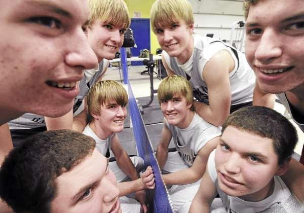 Four of the Medomak Valley basketball team starters are reflected in a mirror at the school's weight room. They are actually two sets of twins who find that communication and playing together for many years helps them on the court.  Pictured are Isaac Darkee (top left), Kyle Darkee (bottom left), Isaac Greenrose (center top) and Alex Greenrose.