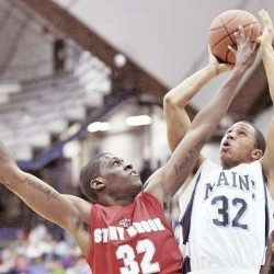Maine's Gerald McLemore (32) puts up a second-half shot over Stony Brook's Anthony Mayo (32) in Orono, Maine Saturday night, Jan. 22, 2011. Maine won 70-59.