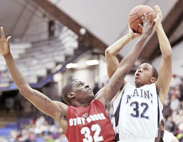 Maine's Gerald McLemore (32) puts up a second-half shot over Stony Brook's Anthony Mayo (32) in Orono, Maine Saturday, Jan. 22, 2011.