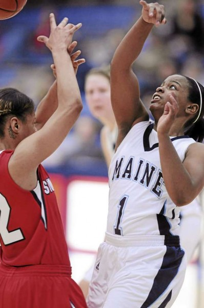 Maine's Ashleigh Roberts, right, and Stony Brook's Kirsten Jeter battle for a loose ball on Sunday January 23, 2011 at Orono. Stoney Brook won 73-70.