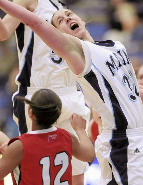Maine's Amber Smith stretches for a rebound against Stony Brook on Sunday January 23, 2011 at Orono. Stoney Brook won 73-70.
