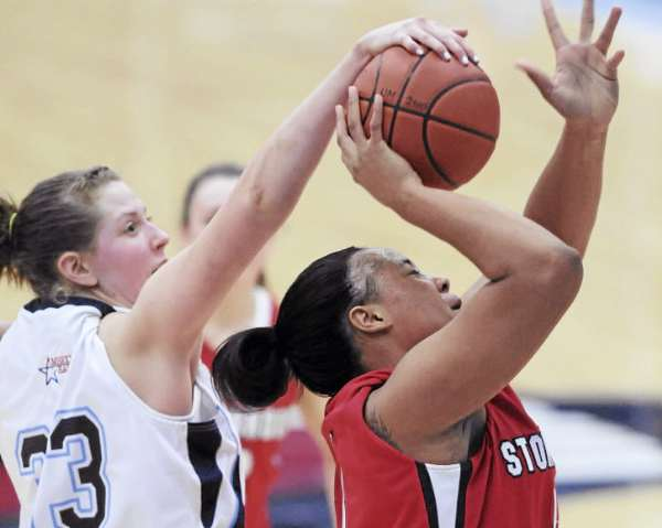 Stony Brook's Juanita Cochran, right, has the ball strpped from her by Maine's Alison Nalivaika on Sunday January 23, 2011 at Orono. Stoney Brook won 73-70.