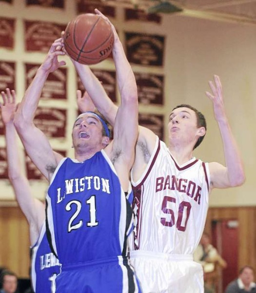 Bangor High School's Patrick Stewart (right) and Lewiston High School's Corbin Hyde go up for a rebound during the first half of the game in Bangor Tuesday evening.