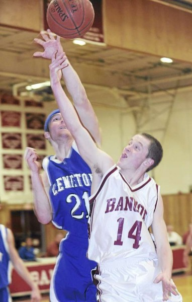 Bangor High School's Luke Hettermann (right) is fouled by Lewiston High School's Corbin Hyde as he goes up for a shot during the first half of the game in Bangor Tuesday evening.