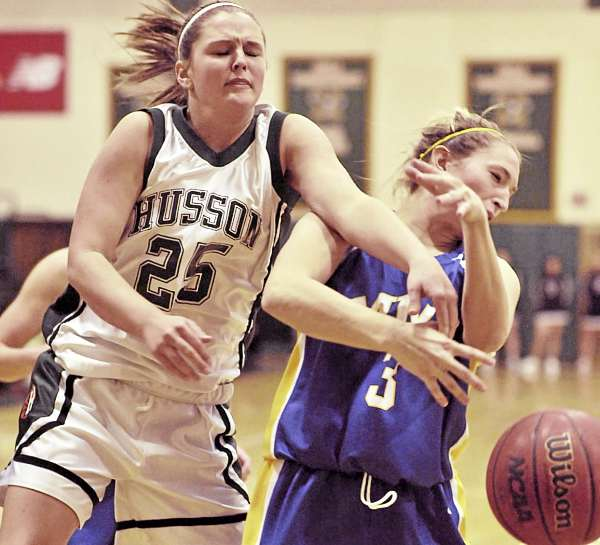 Husson's Haley McGee (25) and MMA's Alexis Bennett (3) collide under the basket while battling for a rebound in the first half of their game in BAngor Wednesday night. MMA won 72-59.