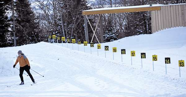 Biathlon volunteer Michelle Anderson of Presque Isle gets in a few laps in the soon-to-be-groomed penalty lap area and shooting range at the Nordic Heritage Center  in Presque Isle just before sunset Wednesday, Jan. 26, 2011. The World Cup Biathlon tour is coming to Presque Isle Feb. 4-6 and to Fort Kent Feb. 10-13.