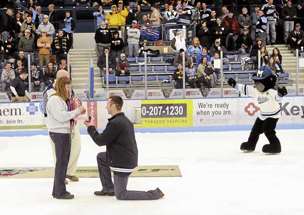 Chris Austin proposes to his girlfriend Heidi Choate on center ice of the Alfond Arena after the first period of the University of Maine versus Boston University hockey game.