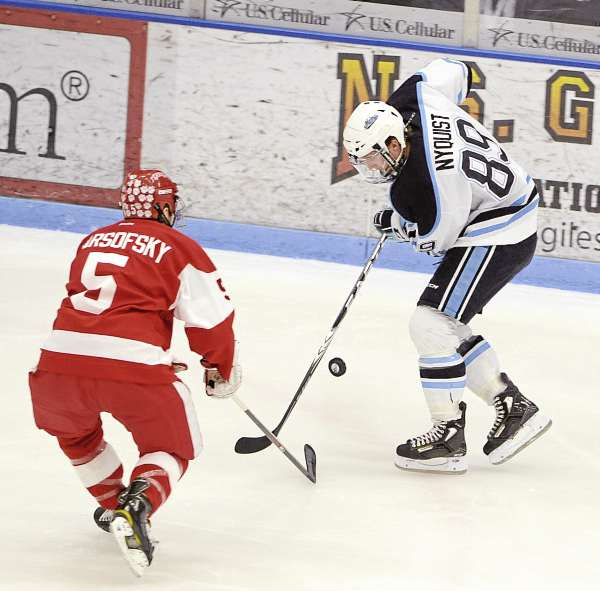 Boston University's David Warsofsky (left) and the University of Maine's Gustav Nyquist battle for the puck during the first period of the game at Alfond Arena in Orono Friday evening.