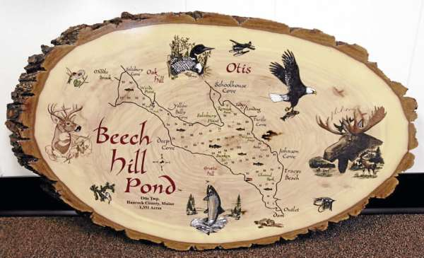 A lake sign of Beech Hill Pond made by Paul Gagnon.