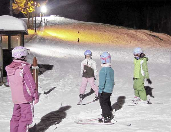 A group of skiers finish up a run on the main trail Friday, January 28, 2011 at the Pinnacle, a publicly-owned ski facility in Pittsfield.