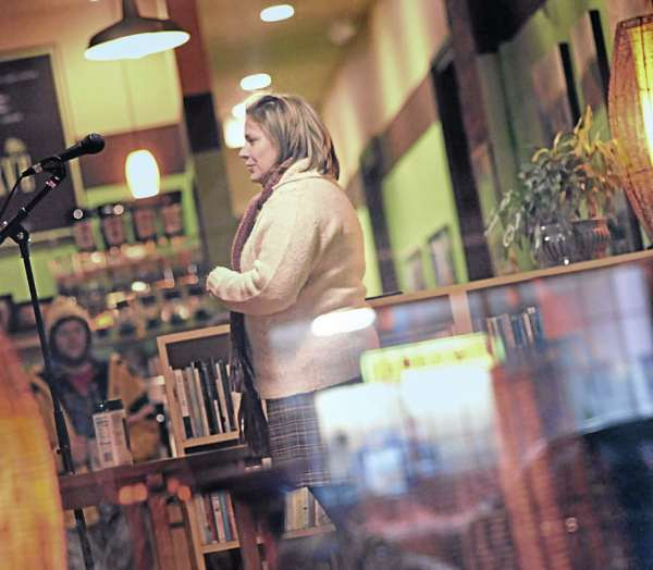 Writer Sarah Smiley is visible through the front window of Verve on Mill Street in Orono, Jan. 9, 2011. Smiley was one of the participants in the Moth Up storytelling program for January.