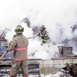 Milford firefighters battle house fire, live power line