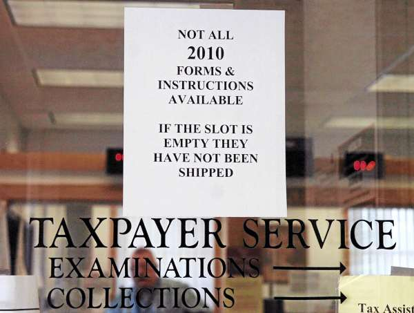 A sign alerting citizens to the lack of 2010 tax forms is displayed on the door of the Bangor office of the Internal Revenue Service on Friday, January 28, 2011. Due to many people downloading their tax forms, the IRS is no longer mailing printed income tax booklets.