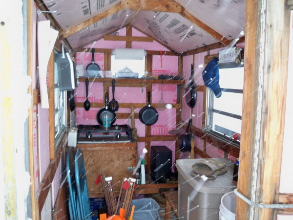 This is an original Shamrock ice shack build in the late 1970's or early 1980's in Oakland. It measures 4x8 feet and contains a two burner cookstove and a propane heater from an old crane engine. It sits on Morrill Pond in Hartland