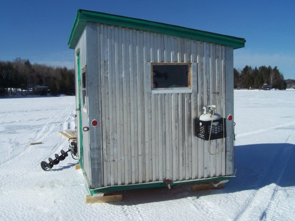 This shack sits on a pair of high density runners, is framed with cedar to keep it light, fully insulated including the floor, rubber roofing, reinforced floor at the fishing holes, tip down cooking table, has a hitch on the back that is connected to the floor framing all the way to the front making it capable of pull-ing another shack or tag sled along with it, has two gas lights and a propane heater, full size tip up comfy bed that only takes up 6&quot of space when not in use, 4 windows, reflectors for night time safety, and it's a fish magnet.
