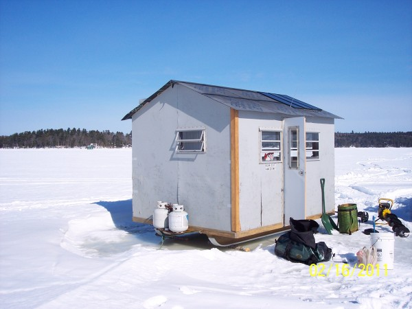 This ice shack is home to the &quotGang Green on Green.&quot Made from mostly recycled parts and powered by solar energy its leading the way in eco-friendly fishing. The interior, door, and windows are recycled from a travel trailer. The lights and radio are powered by solar energy. Cook stove and furnace run on propane. Insulated, warm, and cozy water front property on Green Lake.
