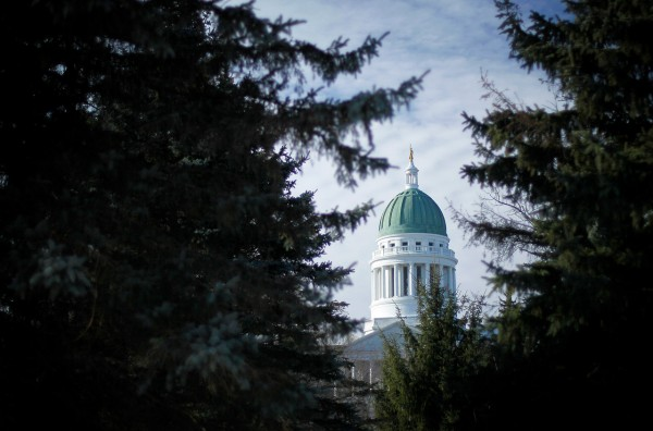 The Maine State House is framed by spruce trees in Capitol Park, Friday, Dec. 10, 2010, in Augusta, Maine. Gov.-elect Paul LePage's transition team are working on a two-year state budget package. The Republican governor-elect promised a restructuring of state government during his campaign to eliminate waste and promote efficiency. (AP Photo/Robert F. Bukaty)