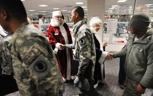 Ritch and Paula Lowney dressed as Santa and Mrs. Claus to great members of the Hawaii Army National Guard 230th Engineer Company at the Bangor International Airport New Year's Eve 2010.  The troops made a stop in Bangor on their way home from Afghanistan and they hope to arrive in Hickman, Hawaii sometime in the morning on January 1st 2011. (Bangor Daily News/Gabor Degre)