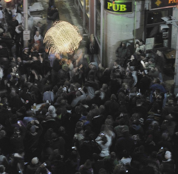 Fest-ees in West Market Square, Bangor, bouce the lighted New Year's ball into the air after it was dropped ceremoniously to signal the start of 2011.