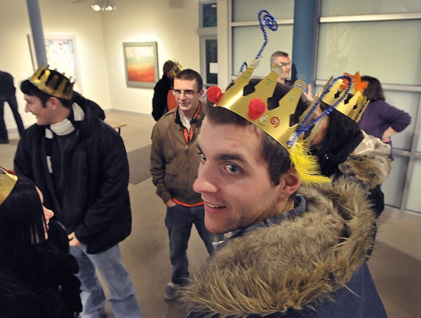 Scott Helmke proudly displays his New Year's crown as he and friends head into the night's festivities from the Maine Art Museum in Bangor, Friday, Dec. 31, 2010.
